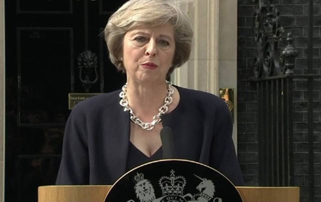 Conservative leader Theresa May addresses the press outside 10 Downing Street. \n