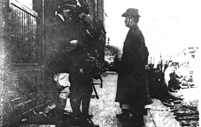 Patrick Pearse surrendering to General at the end of the Easter Rising.