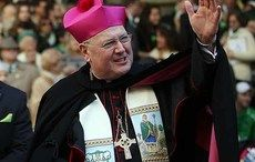 Thumb_cardinal_dolan_wave_pink_hat_getty