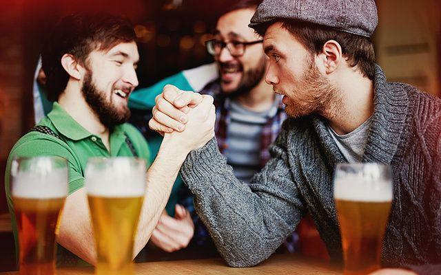 Three Irish men drinking.