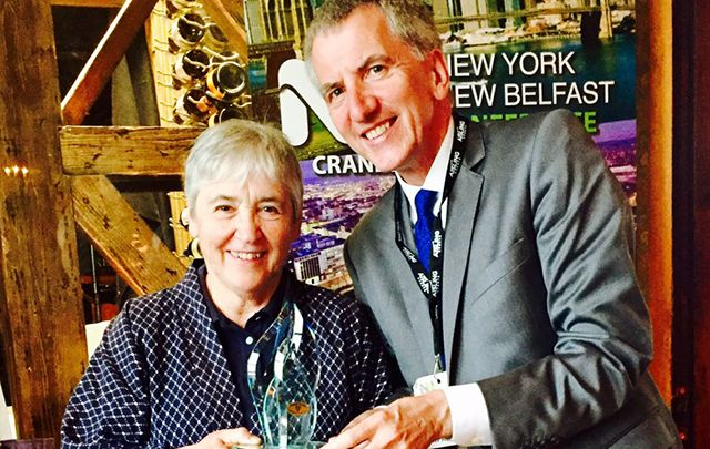 South Belfast Assembly Member and former Finance Minister for Northern Ireland Máirtín Ó Muilleoir presents Professor Maureen Murphy with her Irish American of the Year Award from the Irish Echo, given at the NYNB conference.
