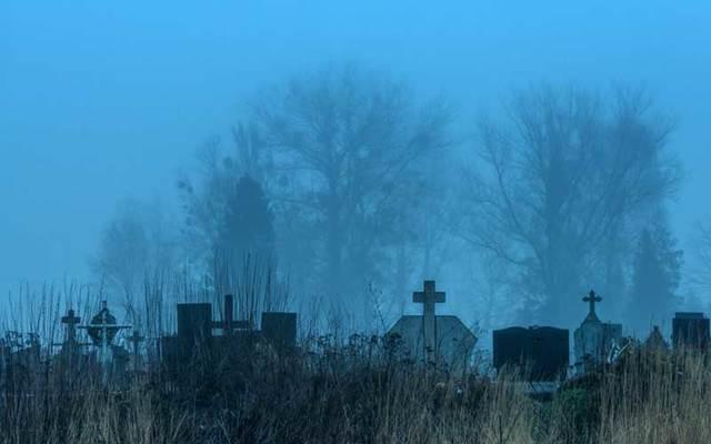 A graveyard at dusk.