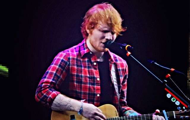 Ed Sheeran performing at the V Festival in Chelmsford.