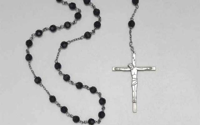 JFK\'s silver and black onyx rosary.