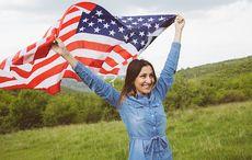 Thumb_mi_fourth_of_july_flag_green_woman_istock