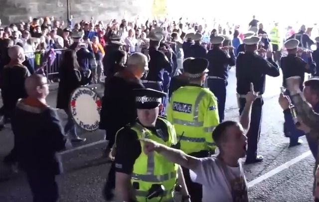 A still from a Twitter video of the Orange Order singing the banned Famine Song in Glasgow.