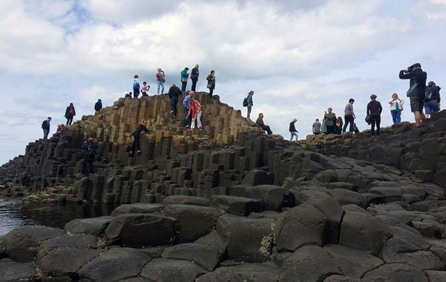 Tourists exploring the Giant\'s Causeway, in County Antrim.