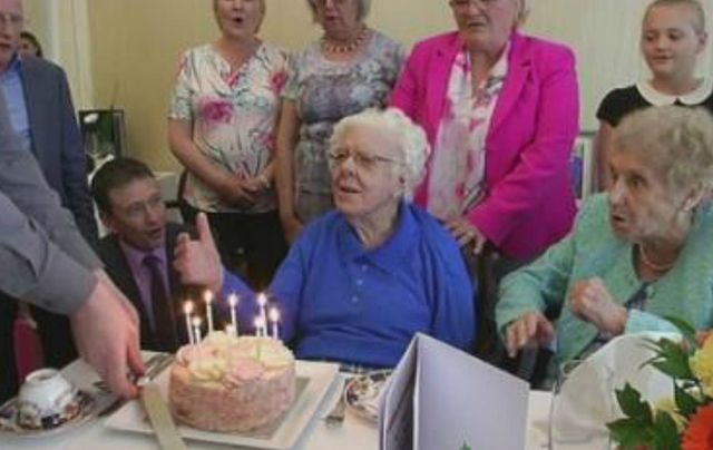 Maud Nicholl celebrating her 108th birthday with family and friend.