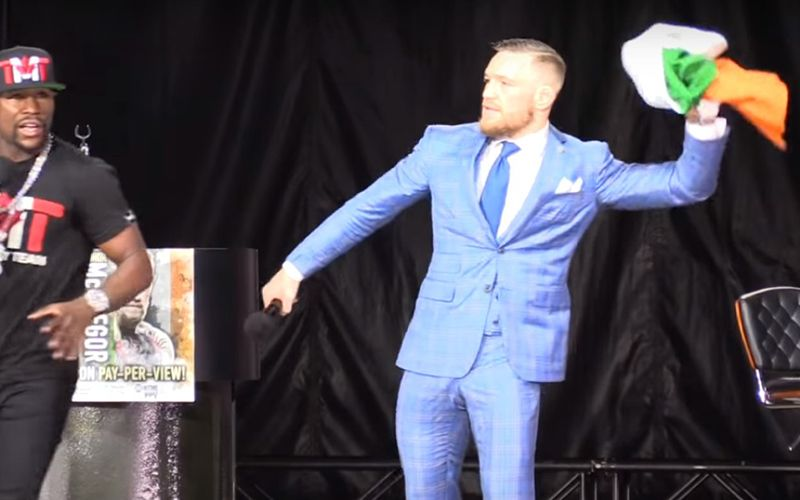 Conor McGregor disrespects his own Irish flag \u2013 throws it to