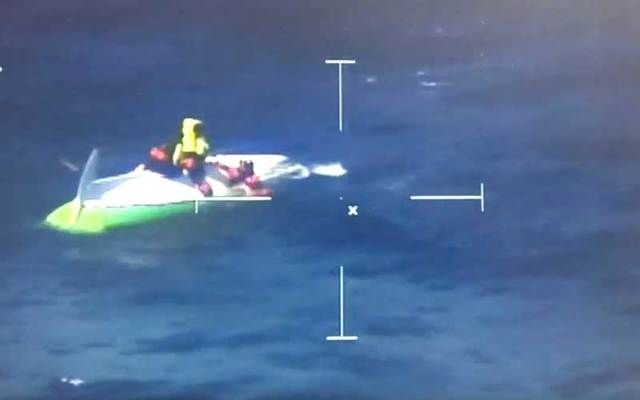 Snapshot of footage of the rescue of two men attempting to row across the Atlantic.