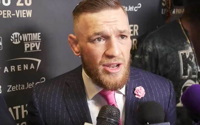 Conor McGregor wears his custom-made David August \'F*** You\' suit.
