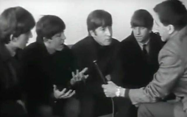 In this snapshot, The Beatles are interviewed by RTE's Frank Hall in Dublin.