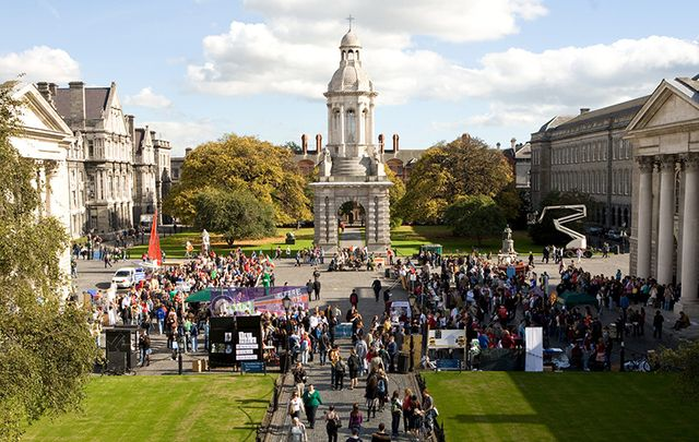 Trinity College Dublin\'s spectacular main square, with the Long Room building to the right.