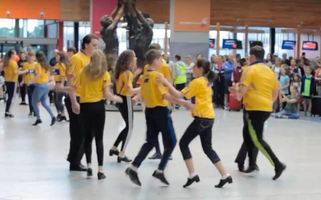 Young Irish flashmob dancers entertain travelers at Shannon Airport.