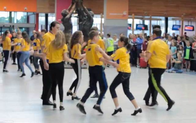 Young Irish flashmob dancers entertain travelers at Shannon Airport.