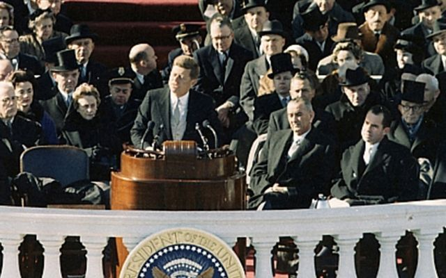 President John F Kennedy give his inauguration speech in 1960, flanked by Lydon B Johnson and Richard Nixon.
