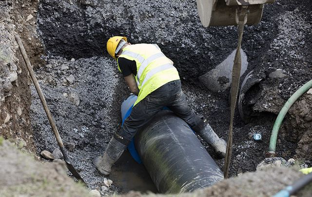 A worker repairs a burst water pipe in Navan, Co. Meath earlier this month – the second time the pipe burst.