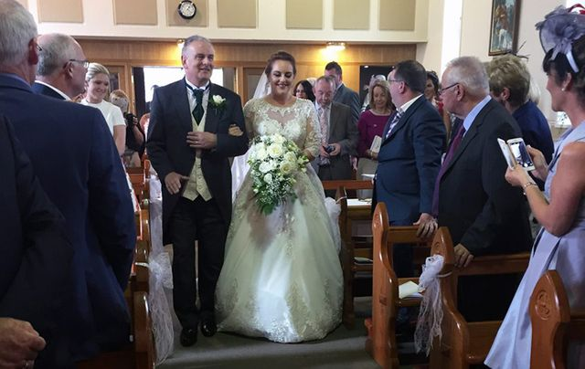 The beautiful Eimear walking up the aisle with her father.