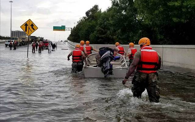 Texas Army National Guard move through Houston streets flooded from Hurricane Harvey on Monday, August 28, 2017.