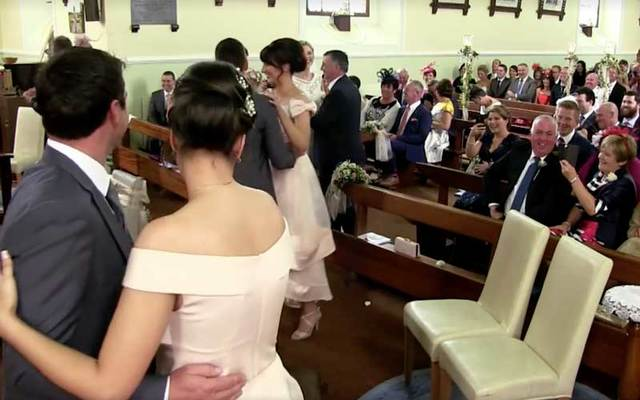 Irish wedding party couples dance in a church in Co. Galway.