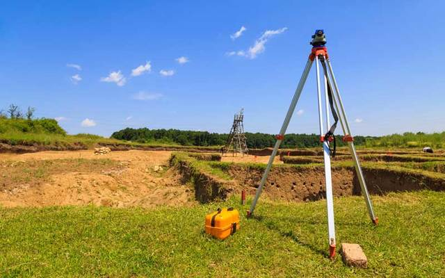 Stock photo of surveying measuring equipment in a field.