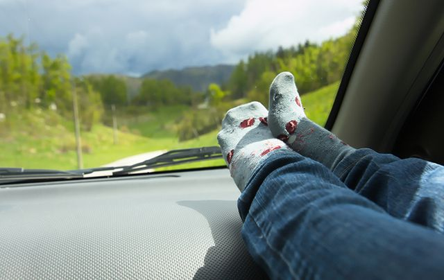 Chilling with your feet up on the dash is not a good idea!