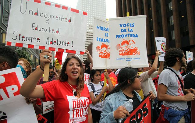 Young Hispanics support the Dream Act at the \'Stop Trump\' march on the first day of the Republican National Convention in 2016.