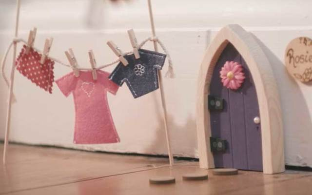 A screenshot of an Irish Fairy Door featured in a company advertisement on YouTube.