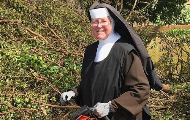 Sister Margaret Ann removes debris obstructing a road after Hurricane Irma