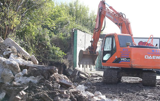 Work has started to remove a security wall that divides Springfield Road and Springhill Avenue. It was erected in 1989 as a security measure to provide extra protection to residents and the nearby New Barnsley police station. Transformation work on the site will include environmental improvements around the land next to two derelict houses and new community artwork.