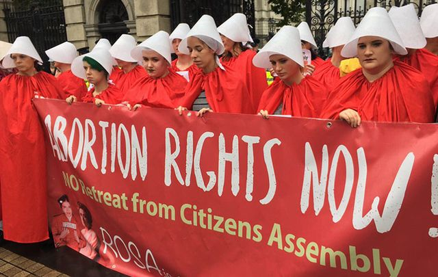 Protesting the eighth amendment of the Irish constitution which completely outlaws abortion, Irish women wore the red cloaks from the popular TV show The Handmaids Tale as they gathered outside Irish government buildings on Wednesday.