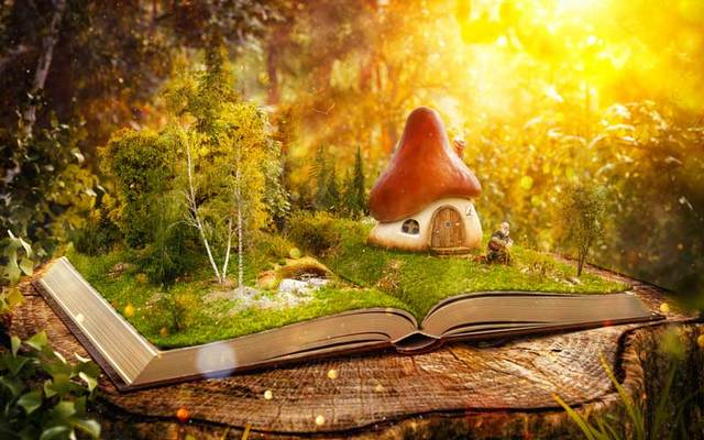Mushroom fairy house scene in an open book.