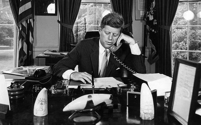 President John F Kennedy on the phone in the Oval Office.