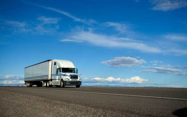 A semi truck on the open road.