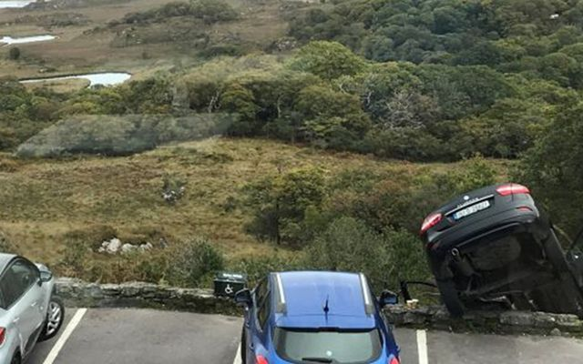 A car dangles precariously over the Ladies View lookout point in Killarney