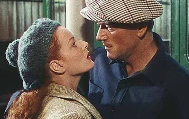 "John  Wayne and Maureen O'Hara kiss outside Ballyglunin Railway Station, in the John Ford classic ""The Quiet Man""."