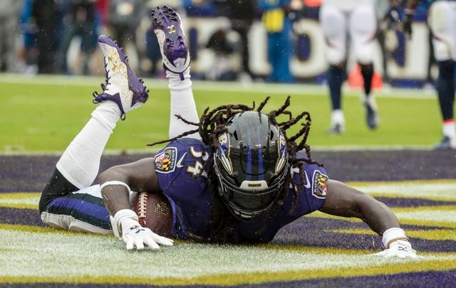 Alex Collins #34 of the Baltimore Ravens scores a touchdown against the Denver Broncos during the first half at M&T Bank Stadium on September 23, 2018, in Baltimore, Maryland.