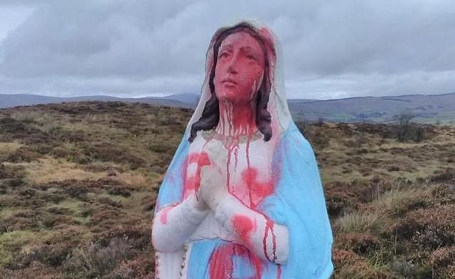 The still unidentified vandals daubed the word 'whore' in red paint across the front of the eight foot statue of the Virgin Mary.