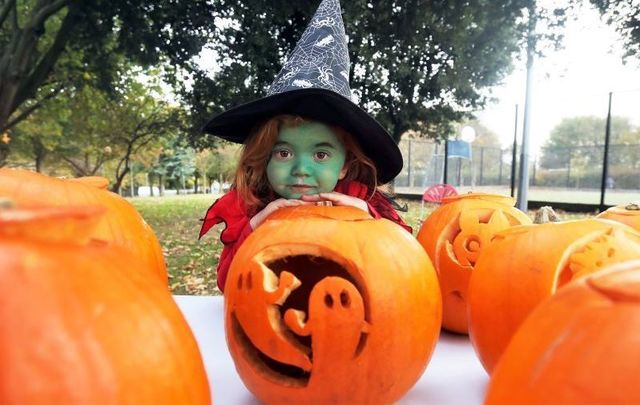 A child dressed as a witch at the Pumpkin Party in Markievicz Park, Ballyfermot, Dublin in 2018.