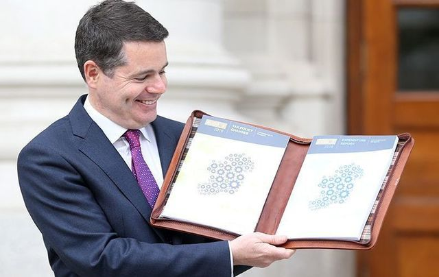 Ireland\'s Minister for Finance Paschal Donohue poses with Ireland\'s 2018 Budget.