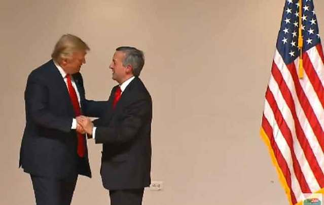 Trump shaking hands with Dr. Robert Jeffress