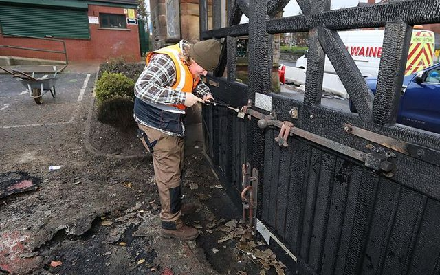 Repairs being carried out on the cemetery gates after the were set on fore over the weekend.