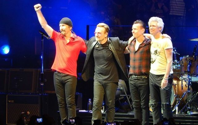 U2 - Bono, The Edge, Larry and Adam, greet the crowds at the United Center, in Chicago.