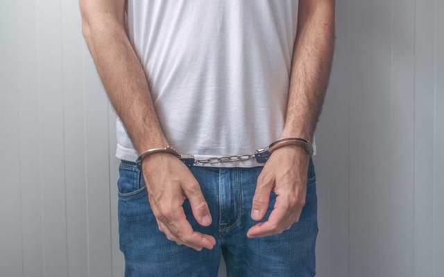 Arrested man in handcuffs.