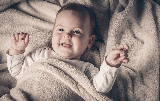 A baby girl laughing.
