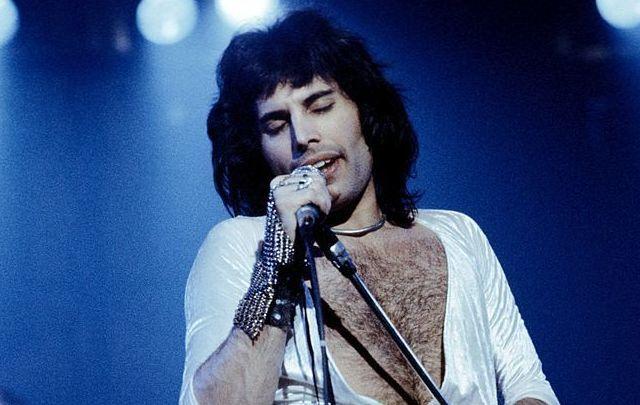 Freddie Mercury (1946 - 1991), lead singer of 70s hard rock quartet Queen, performing live on stage.
