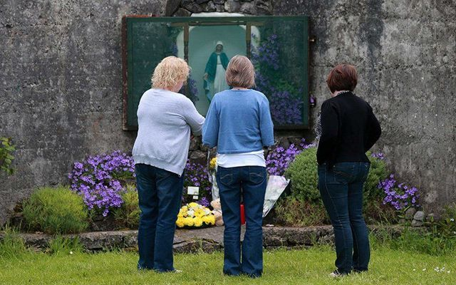 Local women pay their respects at a grotto erected on the site of the mass grave at Tuam, County Galway.