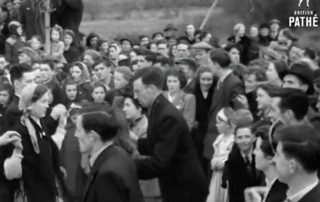 Screenshot of Pathé footage showing Drumshanbo locals dancing at the crossroads on St Patrick\'s Day in 1953.
