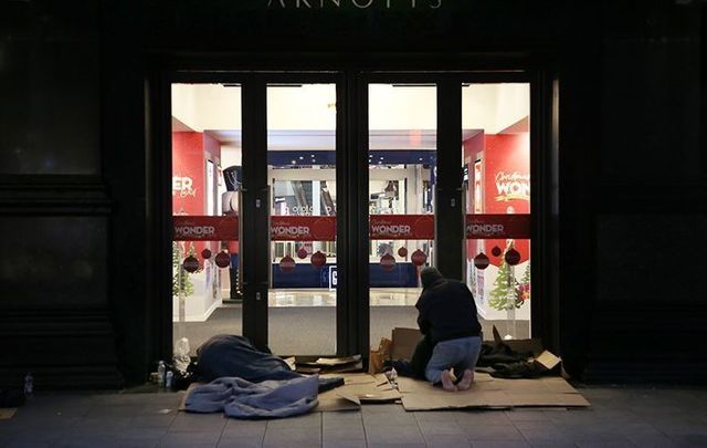 Groups of homeless people camp outside Arnott\'s department store, on Henry Street, in Dublin.