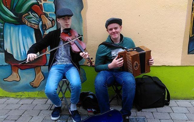 Young men from Tipperary belting out the Irish tunes while busking in Galway.